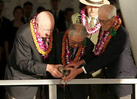 "Dr. Hiroya Sugano(c), former World War Two B25 bomber pilot Jack DeTour(L) and former World War Two Japanese fighter pilot Shiro Wakita pour bourbon whiskey into the ""Remembrance Well"" aboard the USS Arizona Memorial during the ""Blackened Canteen"" ceremony honoring the 74th anniversary of the attack on Pearl Harbor at the World War II Valor in the Pacific National Monument in Honolulu, Hawaii December 6, 2015. REUTERS/Hugh Gentry"